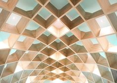 Wooden gridshell forms shelves at Mexico library by Anagrama