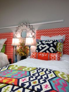 We love this sophisticated dorm room design! Featured Premier Fabric: Sydney Tangelo (headboard and bolster pillow)
