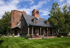 """""""Nestled in the New Hampshire woods, 2.5 hours northwest of Boston, the Rice Mountain estate is an eclectic blend of architectural styles...."""""""