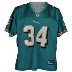 """NFL Reebok Florida Miami Dolphins Ricky Williams Authentic Jersey Teal Nylon by Reebok. $19.99. 100% Nylon. Brand New Item with Tags. Official Licensed Product. Represent your team with this authentic jersey! """"Dolphins"""" screen printed on front panel along with a jumbo sized number """"34"""". Dolphins logo along with Reebok logo screen printed on each sleeve. """"34"""" screen printed on each shoulder pad. """"Williams 34"""" screen printed on the back panel. Sleeves run short. Authentic Reeb..."""