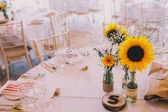 Sunflower centrepieces | | Photography by http://www.saralincolnphotography.co.uk/