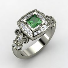 Dauphine Ring. Princess Emerald Platinum Ring with Diamond. ... The fleur-de-lis of the French royal family elegantly flanks the center shield of this vintage inspired design by Jessica Bezhad. This piece will be made to order just for you in your choice of gems and metals. ... $6540