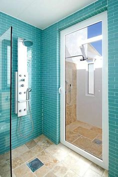 Waking up would be a lot easier with this walk-in, bright turquoise tiled shower!