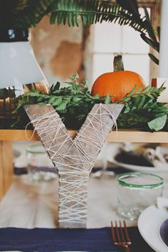 """alphabet table """"numbers"""" // photo by Red White & Green Photography // http://ruffledblog.com/nature-inspired-autumn-wedding"""