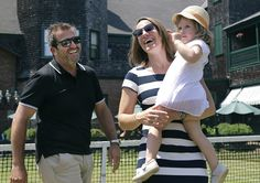 Justine Henin with her husband Benoit and their daughter Lalie.