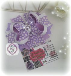 Check out this item in my Etsy shop https://www.etsy.com/uk/listing/254380979/lilac-daisy-stacked-boutique-bow