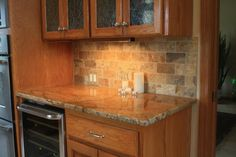 Granite/Natural Stone Slab. Tumbled Stone Subway Tile backsplash. Kitchen http://thekitchenbacksplashideas.com/