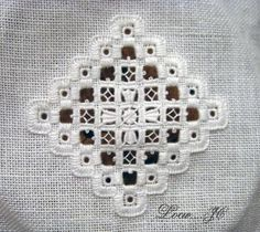 Hardanger cross in a central motif