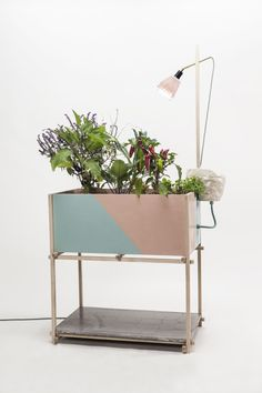 Growth is a minimalist design created by Denmark-based designer K-O-N-T-O Studio. Growth is an indoor urban garden furniture, that works as a biological cycle with a water reservoir, capillary water-system and LED growth-light.