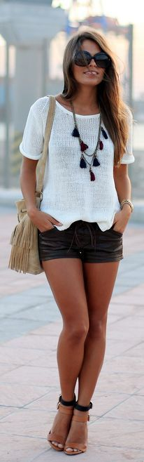 Street style | White knit top, leather shorts, statement necklace and strapped heels