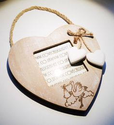 This shabby chic style photograph frame is made of wood cut into a heart shape, with 2 small white wooden hearts attached with rustic string - suitable for hanging on a wall indoors. Perfect as a gift for a Christening, Baptism, Naming Day or new baby gift etc. The frame comes personalised with a stork design as shown in the photo, your own choice of message which is burnt into the wood using a heat controlled pyrography tool and the 2 small hearts are hand painted using acrylics. HOW TO…