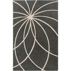 This contemporary rug is hand-tufted in India from 100-percent wool. The graphic geometric design will add instant style to any modern room.