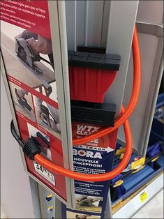 Too, too long for a strip merchandiser hang, this Carpentry Clamp Bungee Cord Merchandising concept is a last resort. Retail Fixtures, Bungee Cord, Clamp, Carpentry, Home Appliances, House Appliances, Woodwork, Joinery, Appliances