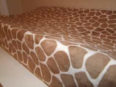 Hey, I found this really awesome Etsy listing at http://www.etsy.com/listing/87268779/giraffe-minky-changing-pad-cover-ships