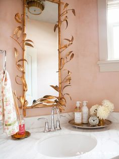 Pink powder room with the most perfect gold mirror! New World Estate Interior Design | Alice Lane Home Collection