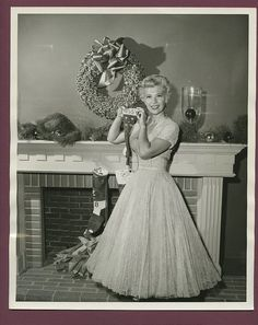 Love the feminine frock actress/singer Dinah Shore is sporting in this delightful Christmas image from 1954