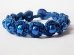 Blue beaded lucet bracelet with button fastening and embroidery thread Spool Knitting, Lucet, Embroidery Thread, Weaving, Beaded Bracelets, Buttons, Unique Jewelry, Handmade Gifts, Projects