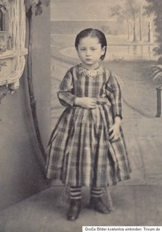 post mortem photography... this poor little girl is propped up and posed for a souvenir for the family...