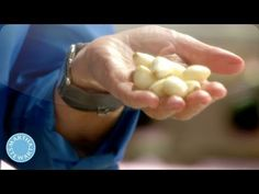 Peel a whole head of garlic in just seconds! Video from Martha Stewart's Cooking School.
