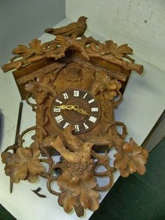 LARGE FANCY CARVED ANTIQUE CUCKOO CLOCK