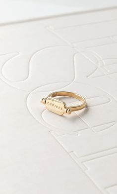 Choices flipping ring in gold vermeil. Ingrid Nilsen x Mejuri limited edition