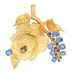 Gold, Carved Bone, Sapphire and Diamond Rose Clip-Brooch  The sculptural brooch centering a rose of carved bone, enhanced by one small round diamond and 3 small sapphires, set on a textured gold branch with leaves, amongst 8 cushion-shaped sapphires approximately 10.00 cts. and 8 small round sapphires, one leaf set with one round diamond, approximately 39.4 dwt.