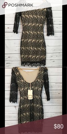 Chelsea and Violet Black and Nude Dress This dress is gorgeous! It has beautiful Lace 3/4 sleeves, and black sequins that make this dress classy and ready for a special night. Side half zipper under arm. Chelsea & Violet Dresses Midi