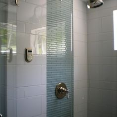different sizes of white tiles. vertical band of glass