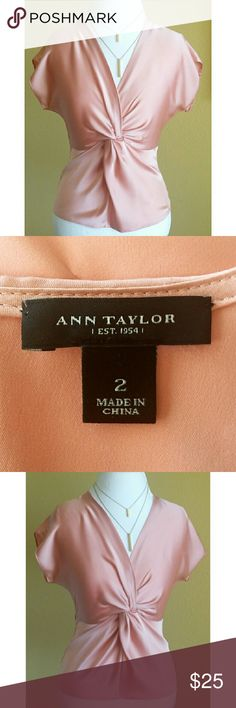 Beautiful Ann Taylor Top Color is Blush or a light salmon~ a gorgeous flattering color!!  Worn lightly twice and in perfect condition.  No flaws!  Tiny clasp at the V Neck to keep the material flush against your chest area. Zips in the back.  Material : 97% Polyester/2% Spandex Ann Taylor Tops Blouses