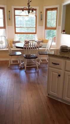 Took awile to save up but here they are Pergo Nashville Oak floors. I adore the modern, farmhouse look of them.