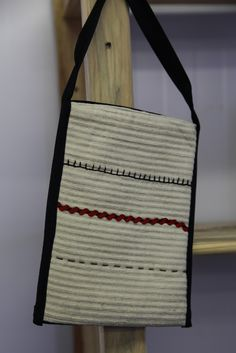Simple lines and hand embroidered details make this cross body bag one of a kind!