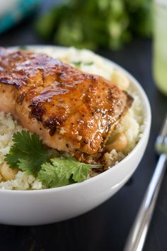 Agave Chipotle Glazed Salmon is the best of both worlds - sweet and savory! Tender salmon coated in a homemade sauce of agave, chipotle peppers, garlic and lime and served over low carb Macadamia Cauliflower Rice!