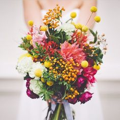 Bold colours, Billy Buttons and Dahlias in a beautifully unconstructed posy. So in love with this wild bouquet by @the_sisters! Photo by @ninaclairephotographer #wedding #weddingflowers #bouquet #weddingbouquet #flowers #billybutton #dahlia #weddingideas #bridal #bridalbouquet #pretty #floral
