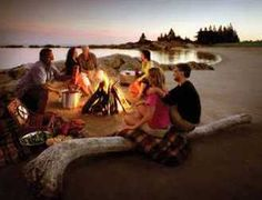 Campfires, especially off some natural waterway, w/ good friends:)