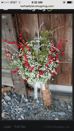 Red berry and babies breath bouquet. Photo by #rachaeltyler #rachaeltylerphotography #winterwedding