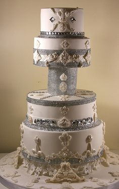 Bling wedding cake : The ultimate princess cake - A four tier bling wedding cake decorated with rhinestone/diamante bands, Swarovski crystals and gems and royal motifs.