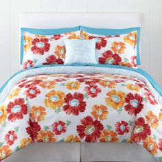 <p>Transform your space into a beautiful, relaxing flower garden with our Madison bedding ensemble, featuring soft floral patterns on a rich background.</p><ul><li>pretty floral design with red, orange and blue tones on a white background</li><li>horizontal chevron pattern in blue and white on back</li><li>includes coordinating microfiber sheet set</li><li>fitted sheet fits mattresses up to 12
