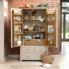 Oak larder with double doors offering versatile and expansive storage options. #shelfie #larderorganisation #larderideas