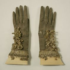 Gloves  Date:     ca. 1670 Culture:     British Medium:     leather, metal, silk Dimensions:     Length: 11 3/8 in. (28.9 cm) Credit Line:  ...