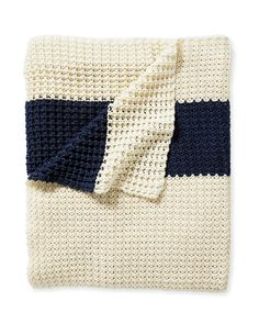 As soft as your coziest sweater, we can't get enough of this amazing throw. The palette is timeless and we love the simplicity of the bold navy band against the ivory ground. A self-bound edge keeps the look streamlined.