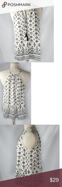 Joie Womens Silk Tunic Tank Top XS Ikat Print Gorgeous women silk tunic Top by Joie. Women's size extra small but as it is a tunic style it feels like it will fit a small as well. the flat underarm to underarm measurement is 19 in the length from shoulder to hem is 23 in. There is one small area with some very faint markings on it I have done my best photograph them but they are really hard to photograph as they are so small. Joie Tops Tunics