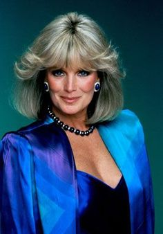 Linda Evans as her character Krystle Carrington wearing this silk multi-coloured cover.