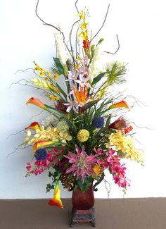 Custom design tropical arrangement by Arcadia Floral & Home Decor.