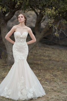 Lace and sequins compose the longline bodice of this strapless, fit and flare wedding gown. Try this wedding gown on today at The Gown Gallery! Davids Bridal Gowns, Bridal Wedding Dresses, Wedding Dress Styles, Bridesmaid Dresses, Gatsby Wedding, Fitted Wedding Gown, Bella Bridal, Gown Gallery, Bridal Dress Design