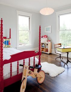 Love these fresh blue walls & glossy red bed. (from Little Moth)