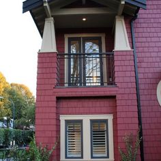 Large Heritage Home with Red Exterior: Undeniable Balcony Addition For Kitsilano Heritage Home Exterior Design Completed With Simple Railing In Black To Match With Roofing Line Exterior House Colors, Exterior Paint, Exterior Design, Modern Design Pictures, Cedar Homes, Purple Home, Traditional Exterior, Brown Walls, Craftsman Style