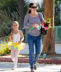 """Courteney Cox and Coco  """"Coco loves to dress up,"""" Cox told Ellen DeGeneres. """"[But at her school] you can't wear certain clothes because -- I'm not sure -- they're too risque?"""""""