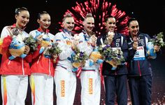 Silver medal winners Jiang Tingting and Jiang Wenwen of China (L), Gold medal winners Svetlana Kolesnichenko and Svetlana Romashina of Russia (C), and bronze medal winners Carbonell Ballestero and Margalida Crespi Jaume of Spain celebrate on the podium after the Synchronized Swimming Duet Free Final on day six of the 15th FINA World Championships at Palau Sant Jordi on July 25, 2013 in Barcelona, Spain.