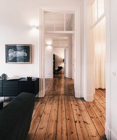 Studio GA Architecture tries to create a natural sense of the modern interior design in this apartment. That's why there are no many colors that they used to design the interior. House Goals, Cozy House, White Walls, Home Fashion, Travel Fashion, Home And Living, Living Room, Simple Living, My Dream Home