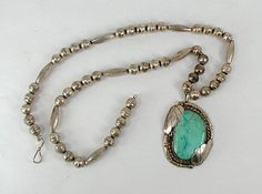 Vintage Native American sterling silver bead necklace with turquoise pendant